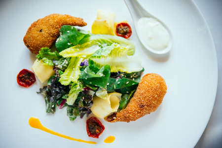 close up food: Batter-fried shrimps and salad served on a plate