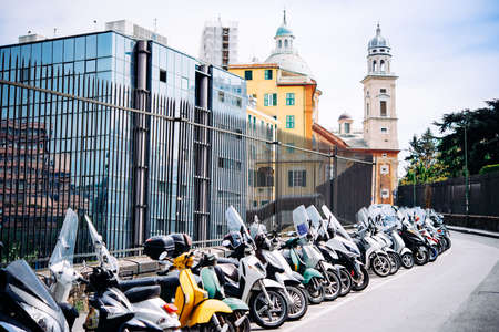 Bikes and scooters parked in the old city of Genoa in Liguria region, Italy.