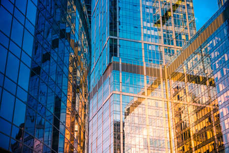 modern building: Glass wall of modern skyscraper building. Success, business and development concept or background Stock Photo