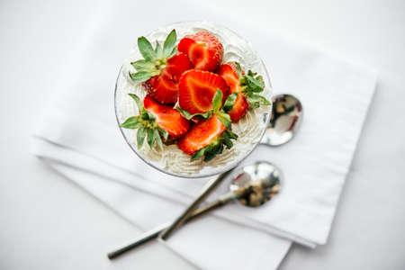 white yummy: Strawberries with whipped cream dessert Stock Photo