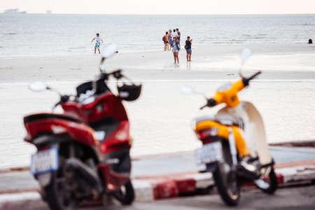 KOH SAMUI, THAILAND - FEBRUARY 18, 2016: People walk in low tide at the seashore of Koh Samui, Thailand. Editorial