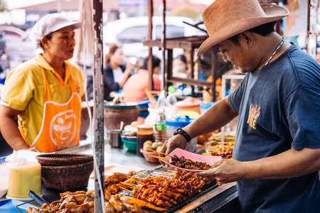 KOH SAMUI, THAILAND - FEBRUARY 18, 2016: Street food market in one of the villages of Koh Samui, Thailand. Editorial
