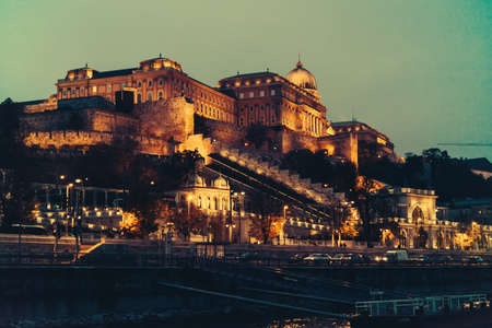 View of the Castle hill lit by the evening lights in Budapest, Hungary.
