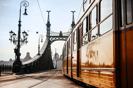 A tram entering Liberty bridge in Budapest, Hungary. Stock Photo
