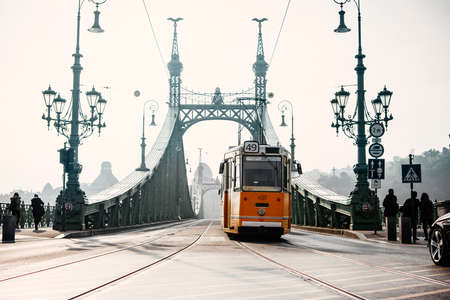A tram entering Liberty bridge in Budapest, Hungary. Editorial