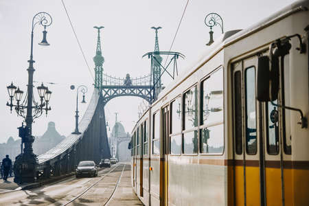 A tram entering Liberty bridge in Budapest, Hungary. Toned picture 新聞圖片