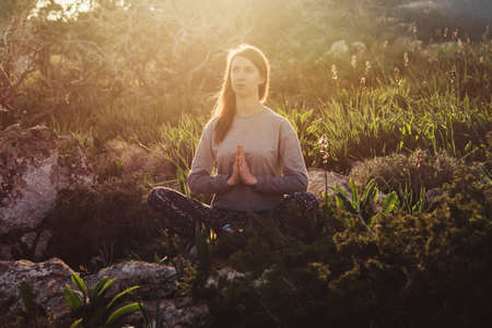 Young beautiful woman meditates during her walk in the nature. Stock fotó - 83825821