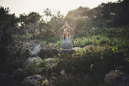 Young beautiful woman meditates during her walk in the nature. Stock fotó - 83825822