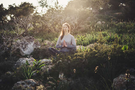 Young beautiful woman meditates during her walk in the nature. Stock fotó - 86660419