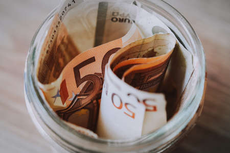 Euro bills in a glass. Savings concept