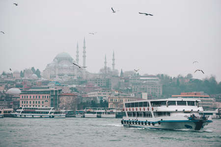 Boats sail along the Golden Horn in Istanbul, Turkey.