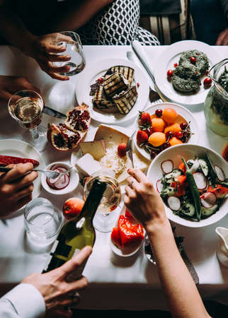 Party dinner table, celebrating with friends of family served at home or in a restaurant.