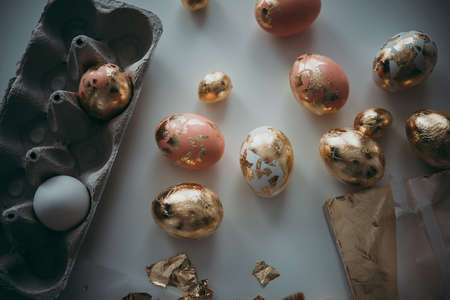 Modern style easter eggs in a box. Gold foil and pink acryllic pain hand made art