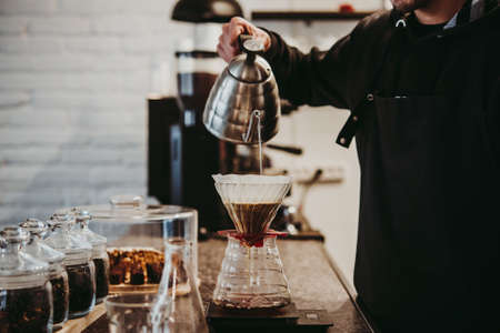 Making pour-over coffee with a filter dripper Stok Fotoğraf - 96945773