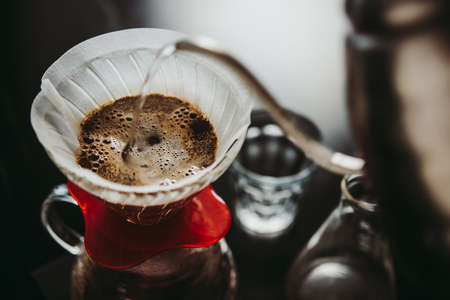 Making pour-over coffee with a filter dripper