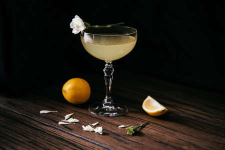 Alcoholic cocktail with lemon