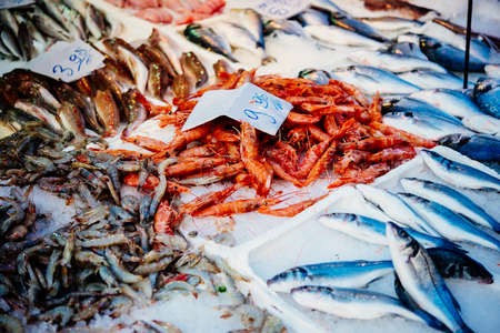 Different kinds of fish on sale at a fish market in Naples, Campania, Italy. Stock Photo