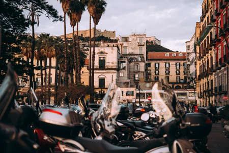 View of parked motorbikes in one of the streets in Naples, Campania, Italy.