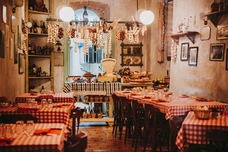 View of a small local restaurant or trattoria in Italy 스톡 콘텐츠