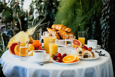 Continental breakfast served in a garden or cafe.