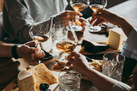 Wine and cheese served for a friendly party in a bar or a restaurant. Stock Photo