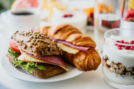 Healthy breakfast served with coffee, frouts and sandwiches and muesli