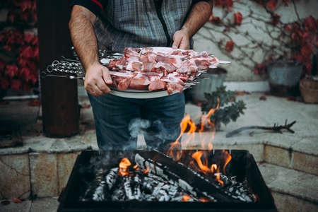Preparing classic style barbecue in a countryside.