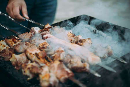 Grilling classic style barbecue in a countryside.