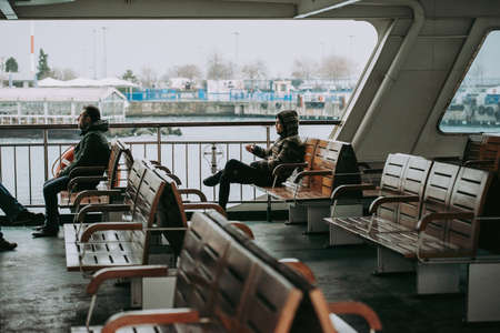 ISTANBUL, TURKEY - 28 JANUARY, 2017: Passengers travel on a ferry boat across the Bosphorus in Istanbul, Turkey.
