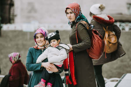 ISTANBUL, TURKEY - 29 JANUARY, 2017: Young turkish women with children near the Blue Mosque in Istanbul, Turkey. Editorial