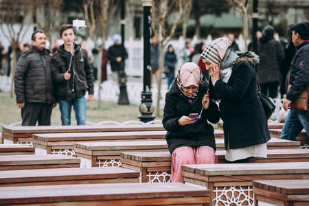 ISTANBUL, TURKEY - 29 JANUARY, 2017: Turkish girls looking in a smartphone