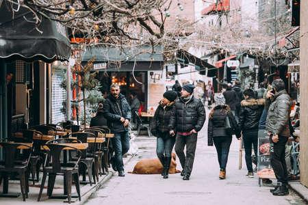 ISTANBUL, TURKEY - 29 JANUARY, 2017: People walk along the streets of Karaköy district in Istanbul, Turkey.