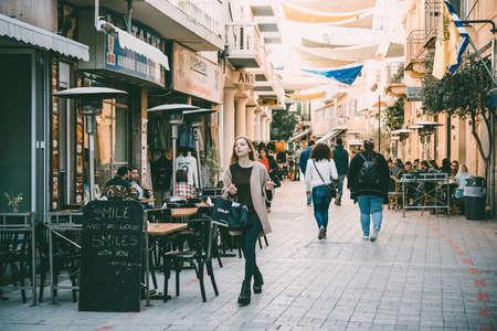 NICOSIA, CYPRUS - 18 MARCH, 2017: People walk along one of the streets of Nicosia, Cyprus.