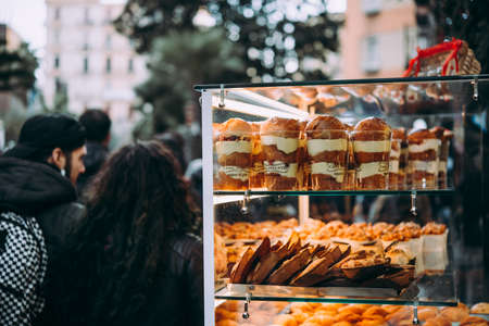 NAPLES, ITALY - 17 DECEMBER, 2017: A vendor sells street food sweets and pastry in Naples, Campania, Italy.