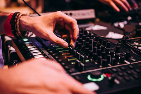 Playing music using an analog synthesizer connected to a modular synthesizer. Electronic music and professional music equipment concept. Reklamní fotografie