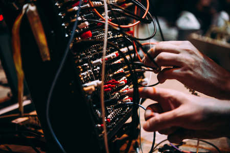 Making music using modular synthesizers. Electronic music and professional music equipment concept. Reklamní fotografie - 121472779