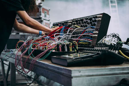 Musician performs on stage using modular synthesizers. Electronic music and professional music equipment concept. Stok Fotoğraf - 121472780