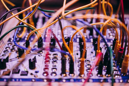 A close-up of a modular synthesizer. Electronic music and professional music equipment concept.