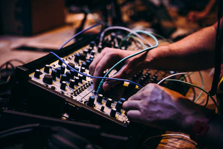 Making music using modular synthesizers. Electronic music and professional music equipment concept. Stok Fotoğraf - 121473272