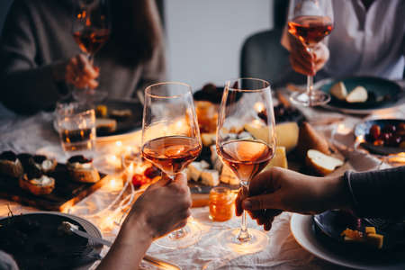 Glasses of rose wine seen during a friendly party of a celebration. Banco de Imagens