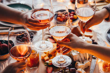 Glasses of rose wine seen during a friendly party of a celebration. Zdjęcie Seryjne