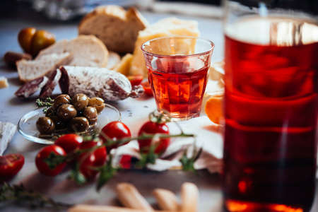 Mediterranean snack with a  glass of rose wine and different appetisers on the table.