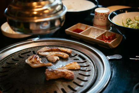 Grilled pork served in one of the traditional Korean barbecue restaurants in Seoul, South Korea. Stock Photo