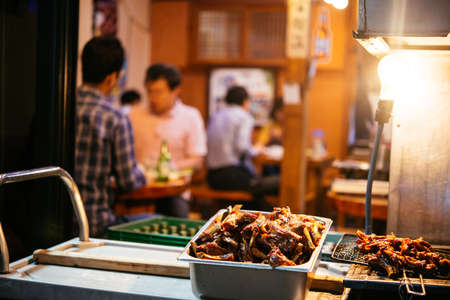 Different street food on sale in the evening streets of Seoul, South Korea.