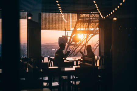 People enjoy the evening city view in one of the restaurants in Seoul, South Korea. Stock Photo