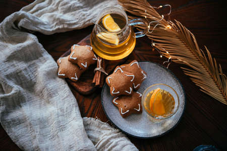 Hot beverages tea or mulled white wine served with gingerbread. Christmas celebration concept. Stock Photo