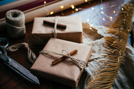 Wrapping presents and making decorations for Christmas or New Year celebration. Stock Photo
