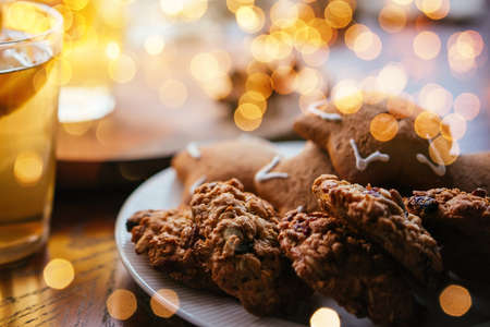Freshly baked cookies on a wooden table. Christmas celebration concept. Stock Photo