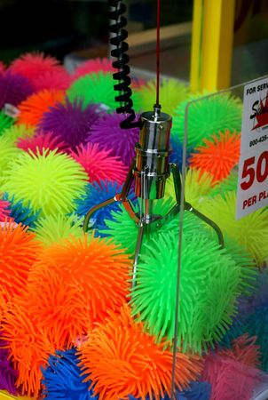 ever: Do people actually ever win the claw game? Stock Photo
