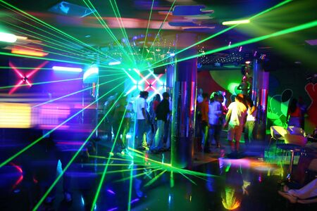 laser show: Party at Disco with young people and fantastic laser show Stock Photo